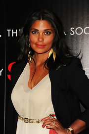 Rachel Roy displayed her perfectly manicured nails featuring glossy candy apple red polish at a screening of 'Safe.'