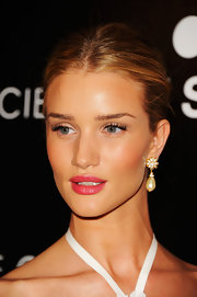 Rosie Huntington-Whiteley went for classic styling with a pair of pearl drop earrings by Miriam Haskell.