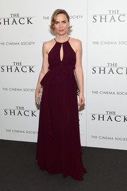 Radha Mitchell donned a floaty burgundy keyhole-cutout gown for the world premiere of 'The Shack.'