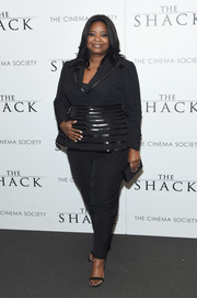 Octavia Spencer rounded out her all-black look with a ribbed box clutch.