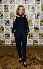 Jena showed off her bare shoulders at the Comic-Con press line for 'The Hunger Games: Catching Fire' where she sported a deep navy jumpsuit with cold-shoulder detailing and a high collar.