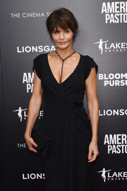 Helena Christensen matched a woven clutch with a little black dress for the New York screening of 'American Pastoral.'