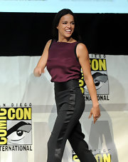 Michelle Rodriguez went for casual elegance in a purple silk tank top and satin-trimmed slacks during Comic-Con.