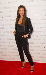 Michelle Keegan added a dose of sexiness to her menswear-inspired outfit with a pair of black and gold strappy sandals.