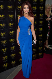 Amy Childs showed off her curves when she wore this electric blue one-shoulder dress with a gathered waist and jeweled detailing.
