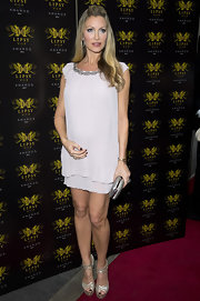 Caprice Bourret opted for a flowing mini dress with an embellished collar.