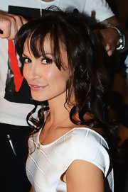Karina Smirnoff got her hair styled in loose curls and chunky bangs.