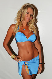 Lisa Blue shows off her beach bod in a charming blue halter bikini that she designed.