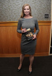 Lisa Niemi Swayze teamed her demure gray sheath with classic pumps at a signing of 'Worth Fighting For.'