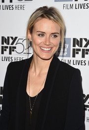 Taylor Schilling adorned her black outfit with a stylish gold pendant for the New York premiere of 'Listen Up, Phillip.'