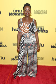 Lupita Nyong'o matched her top with a pair of printed wide-leg pants.
