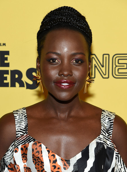 Lupita Nyong'o styled her hair into a braided updo for the New York premiere of 'Little Monsters.'