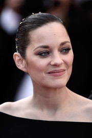 Marion Cotillard wore her hair in a tight bun at the Cannes premiere of 'The Little Prince.'