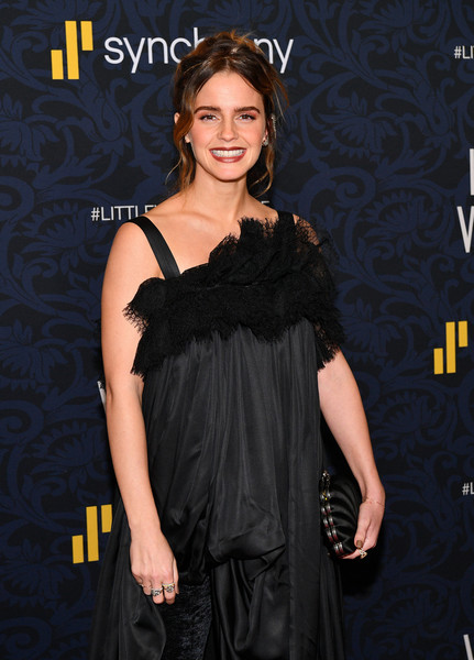 Emma Watson arrived for the world premiere of 'Little Women' carrying a black clamshell clutch by Balenciaga.