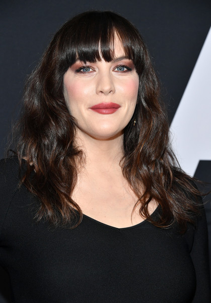 Liv Tyler Long Wavy Cut with Bangs [hair,face,hairstyle,lip,eyebrow,bangs,chin,beauty,brown hair,black hair,arrivals,liv tyler,ad astra,hair,hairstyle,face,the cinerama dome,20th century fox,premiere,premiere,liv tyler,ad astra,the dome entertainment centre,celebrity,photograph,image,getty images,aerosmith,premiere]