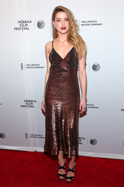 Amber Heard oozed sultry appeal in a sequined bronze slip dress by Temperley London at the premiere of 'When I Live My Life Over Again.'