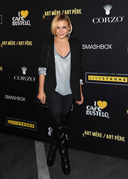 Samaire gave her black blazer a kick with over-the-knee boots.