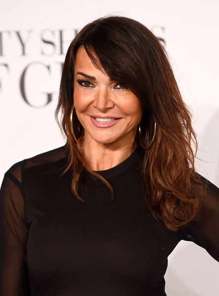 Lizzie Cundy Long Wavy Cut with Bangs [fifty shades of grey,hair,hairstyle,face,beauty,brown hair,long hair,layered hair,black hair,smile,little black dress,red carpet arrivals,lizzie cundy,uk,england,london,odeon leicester square,premiere]