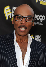 RuPaul paired his navy blue suit with a rectangle shades while attending Logo's Awards.