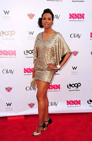 Aisha Tyler wore a shiny pair of gold and black peep toe T-strap heels at the 2012 NewNowNext Awards.