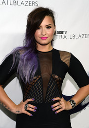 Demi Lovato was edgily styled at the Logo TV Trailblazers event, teaming a spiky two-finger statement ring with a mesh-panel dress.