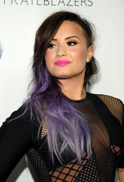 Demi Lovato fixed her half-shaved hair into an edgy side sweep for the Logo TV Trailblazers event.