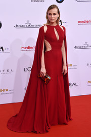 Diane Kruger was a sexy diva at the German Film Awards in a caped, multi-cutout red gown by Naeem Khan.