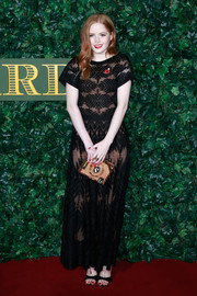 Ellie Bamber chose a sheer, embroidered black gown by Chanel, which she wore with a nude underlay, for the London Evening Standard Theatre Awards.
