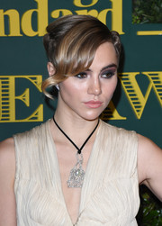 Suki Waterhouse wore her hair in a braided updo with dramatic side-swept bangs at the London Evening Standard Theatre Awards.