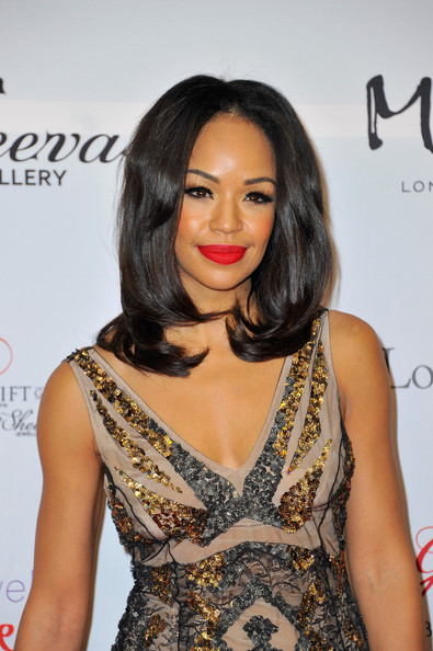 Sarah-Jane Crawford injected a shock of color to her look with a swipe of bright red lipstick.