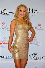Iveta Lukosiute went all out with the glamour at the London Global Gift Gala, pairing a gemstone-inlaid clutch with a gold bandage dress.