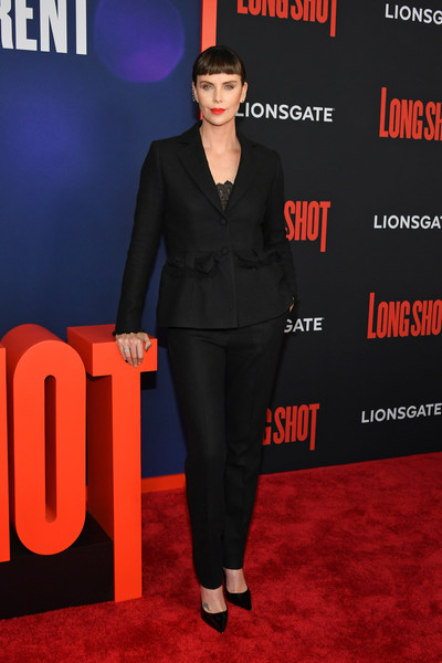Charlize Theron kept it understated yet elegant in a black pantsuit by Dior Couture at the New York premiere of 'Long Shot.'
