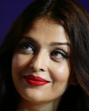 Aishwarya Rai swiped on some bright red lipstick for a dazzling beauty look during the Longines DolceVita Asia Pacific launch.
