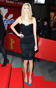 Tamsin Egerton arrived at the Berlinale International Film Festival wearing a strapless lace-trimmed dress.