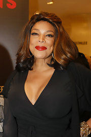 Wendy Williams amped up her all black look with vivid red lipstick.