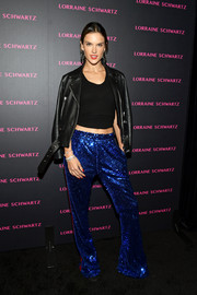 Alessandra Ambrosio was sporty-glam in a pair of side-striped sequin pants by Faith Connexion at the launch of the Eye Bangle.