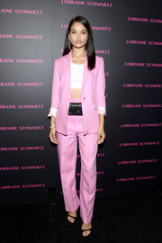 Shanina Shaik stayed cool in a bubblegum-pink suit by Sandro teamed with a white crop-top at the launch of the Eye Bangle.
