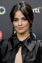Camila Cabello finished off her look with a pair of dangling sphere earrings by Rebecca de Ravenel.
