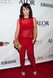 Constance Zimmer was casual-chic in red silk pants and a matching sheer blouse during the LA Confidential pre-Emmy celebration.