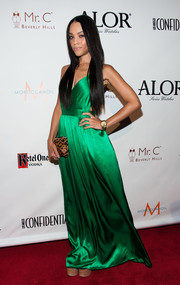 Bianca Lawson chose a simple yet sophisticated emerald-green evening dress for the LA Confidential pre-Emmy celebration.