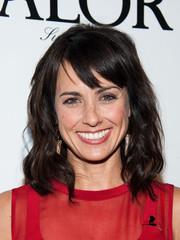 Constance Zimmer wore her hair down in billowy waves with choppy bangs when she attended the LA Confidential pre-Emmy celebration.