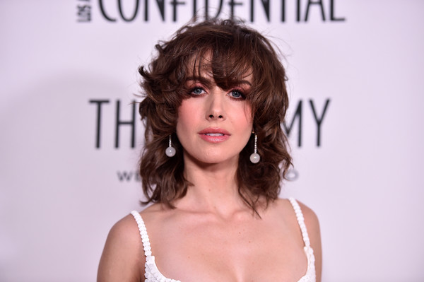 Alison Brie rocked a mussed-up curly hairstyle with eye-grazing bangs at the Los Angeles Confidential awards issue celebration.