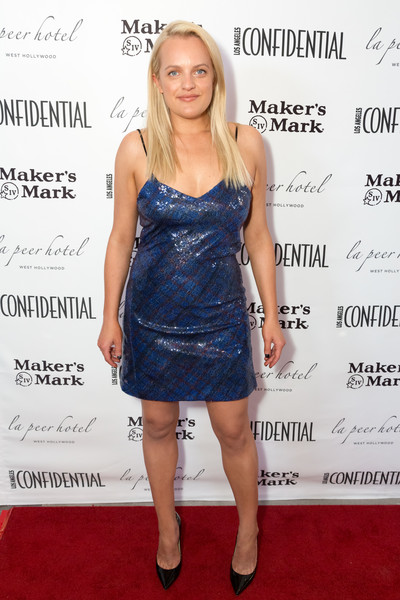 Elisabeth Moss slipped into a blue sequined mini dress by Tommy Hilfiger for the Los Angeles Confidential Emmys celebration.