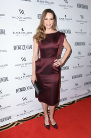 Hilary Swank was sleek and elegant in a structured burgundy cocktail dress by Lanvin at the Los Angeles Confidential Women of Influence issue celebration.