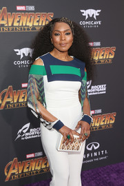 Angela Bassett teamed a studded box clutch with a cold-shoulder jumpsuit for a modern look during the premiere of 'Avengers: Infinity War.'