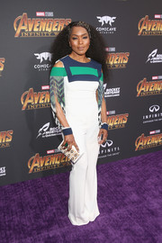 Angela Bassett was modern-chic in a white Mario Dice jumpsuit with a color-block yoke, shoulder cutouts, and fringed sleeves at the premiere of 'Avengers: Infinity War.'