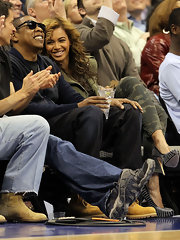 Beyonce seems thrilled with her riveted black leather pumps. They complete her edgy camo ensemble and why not wear them to a basketball game? After all, she is sitting courtside.