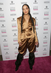 Tessa Thompson rocked a belted gold pantsuit by Alexandre Vauthier at the premiere of 'Little Woods.'