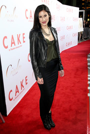 Camille Balsamo walked the 'Cake' premiere red carpet looking edgy in a black leather jacket.