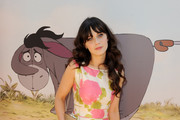 Actress Zooey Deschanel arrives at the premiere of Walt Disney Pictures'